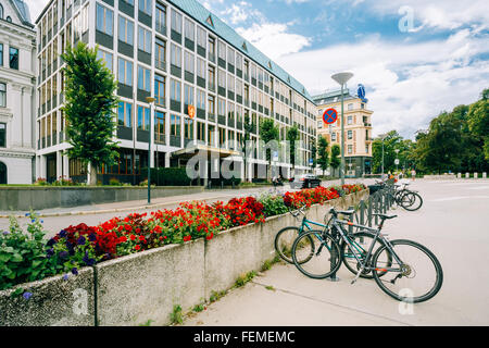 OSLO, NORWAY - JULY 31, 2014: Parked Bicycle On Sidewalk near The Ministry of Foreign Affairs of Norway - Stock Photo