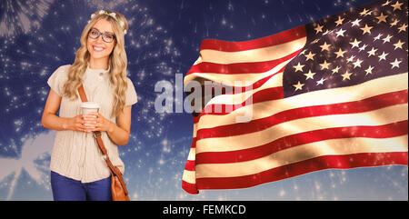 Composite image of gorgeous smiling blonde hipster leaning against red brick background - Stock Photo
