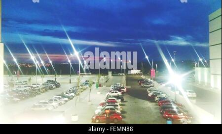 Rows Of Cars Parked In Parking Lot - Stock Photo