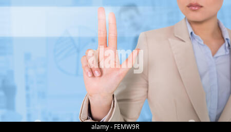 Composite image of businesswoman touching - Stock Photo