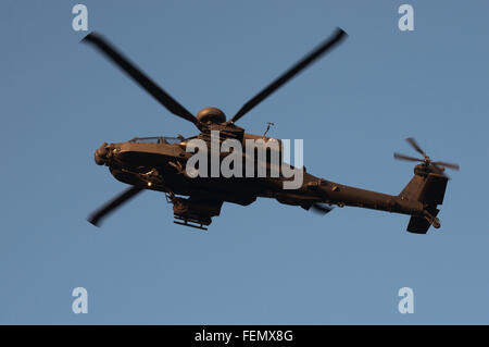 AgustaWestland Apache attack helicopter flown by the British Army Air Corps on a training mission over Woodbridge - Stock Photo