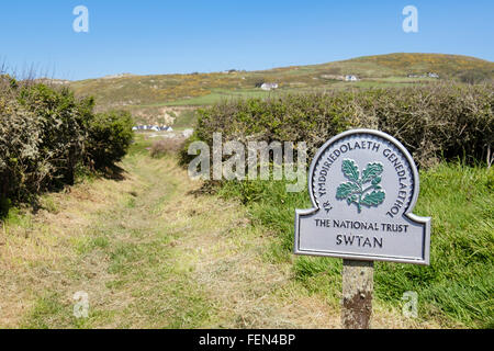 Bilingual National Trust sign on public Isle of Anglesey Coast Path to Church Bay / Porth Swtan Isle of Anglesey - Stock Photo