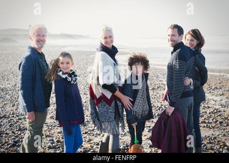 Portrait smiling multi-generation family on sunny beach - Stock Photo