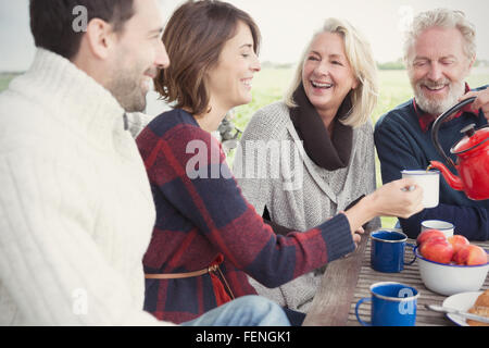 Couples drinking coffee on patio - Stock Photo