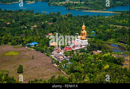 Sitting Buddha temple in Thailand from the air - Stock Photo