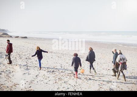 Multi-generation family walking on sunny beach - Stock Photo