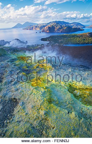 High angle view of coast and sulphur smoke at Gran Cratere, Vulcano Island, Aeolian Islands, Sicily, Italy - Stock Photo
