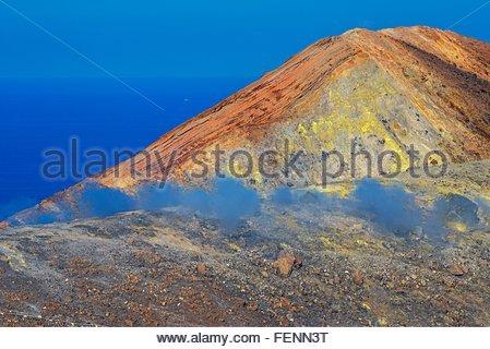 View of coast fumarole and sulphur smoke at Gran Cratere, Vulcano Island, Aeolian Islands, Sicily, Italy - Stock Photo