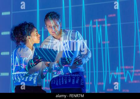 Business people in discussion with graphical data projection - Stock Photo