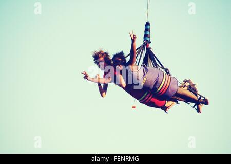 Low Angle View Of Couple Hang Gliding - Stock Photo