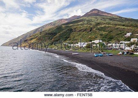 Coast and black sand of beach Stromboli, Aeolian Islands, Sicily, Italy - Stock Photo