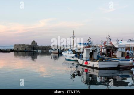 Fishing boats moored in harbour at sunset, Naousa, Paros, Cyclades Islands, Aegean sea, Greece - Stock Photo