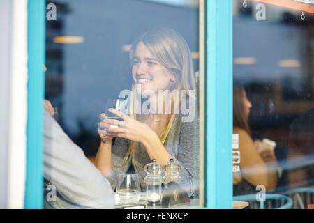 Romantic young couple at cafe having lunch date - Stock Photo