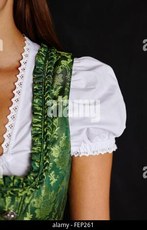 Partial view of young woman in Dirndl - Stock Photo