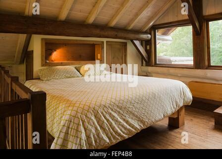 King size bed wooden bed frame master bedroom mezzanine handcrafted stock photo royalty free - Bed mezzanie kind ...
