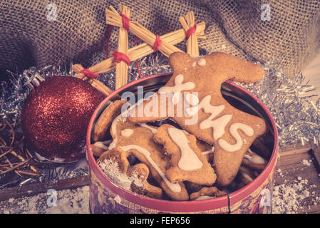Homemade cookies in a tin for Christmas - Stock Photo
