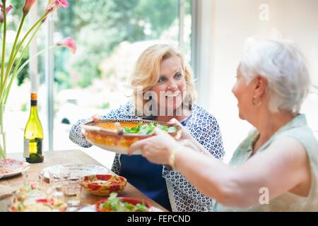 Two women having lunch together, at home - Stock Photo