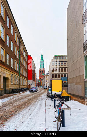 View on Former St Nicholas church in Copenhagen, Denmark in winter. The Nikolaj Contemporary Art Center is an arts - Stock Photo