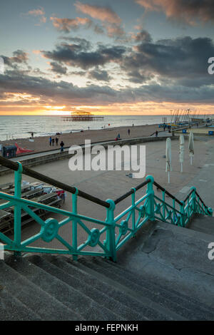 Winter sunset on Brighton seafront, East Sussex, England. West Pier ruins in the distance. - Stock Photo