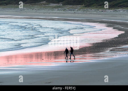 Beach walk at sunset, Long Beach, Tofino, British Columbia - Stock Photo