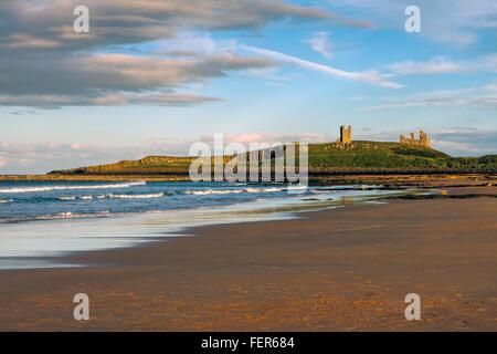 Sunset over Dunstanburgh Castle Stock Photo