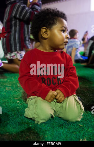 A little boy in red shirt at a park - Stock Photo