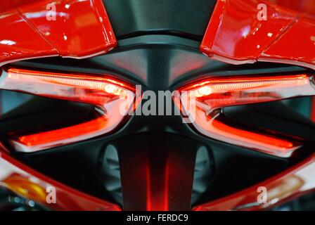 Close-Up Of Tail Lights Of Motor Scooter - Stock Photo