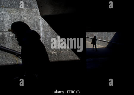 High Angle View Of Silhouette Women Walking In Subway On Sunny Day - Stock Photo