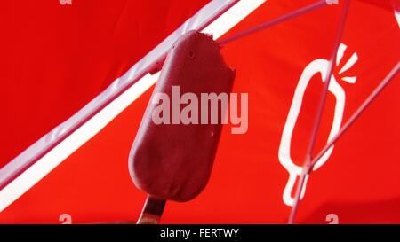 High Angle View Of Ice Cream Against Red Parasol - Stock Photo