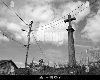Low Angle View Of Cross Sculpture Against Cloudy Sky At Villefranche-Sur-Saone - Stock Photo