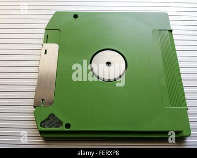 High Angle View Of Green Floppy Disk - Stock Photo