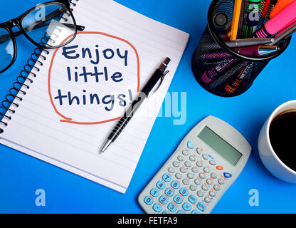 Enjoy little things word on notepad - Stock Photo