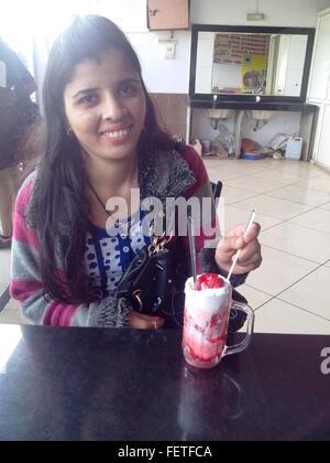 Woman Having Dessert In Cafe - Stock Photo