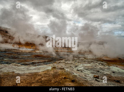 Northeast Iceland, Iceland. 1st Aug, 2015. Steam and smoke from boiling mud pools and steaming fumaroles drifts - Stock Photo