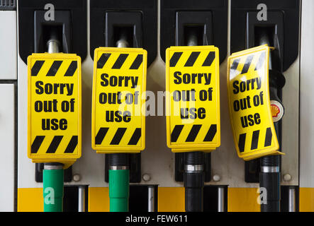 Sorry out of use signs on petrol pumps at a garage - Stock Photo
