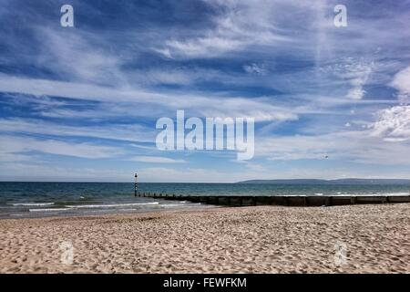 Scenic View Of Bournemouth Beach Against Cloudy Sky - Stock Photo
