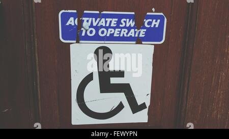 Close-Up Of Disabled Sign On Door - Stock Photo