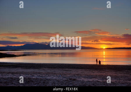 Sunset over Ganavan sands and a distant Mull, Oban, Argyll - Stock Photo