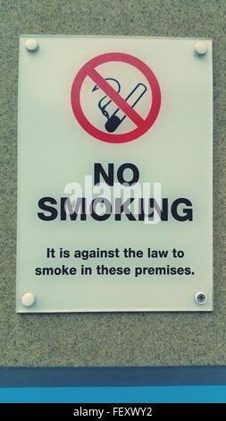 Close-Up Of No Smoking Sign On Wall - Stock Photo