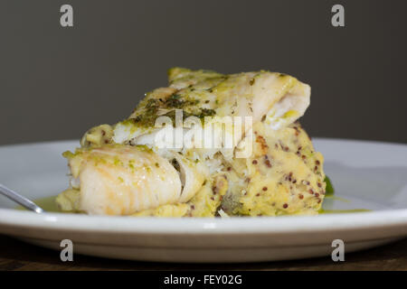 Haddock with whole grain mash and garlic parsley butter. French restaurant prepared fish dish with mashed potato - Stock Photo