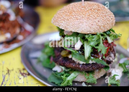 Close-Up Of Burger In Plate On Table - Stock Photo