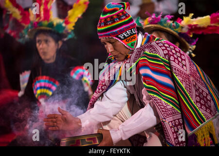 Indigenous ceremony to payment Pachamama. International festival of folk dances El Buen Pastor School, municipality - Stock Photo