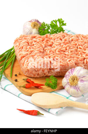 raw minced meat and other ingredients on cutting board - Stock Photo