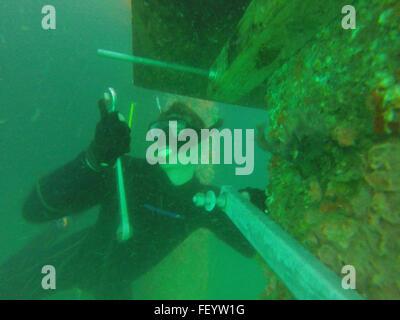 PEARL HARBOR (Jan. 12, 2016) - Hospital Corpsman 1st Class James Aldridge, assigned to Underwater Construction Team - Stock Photo