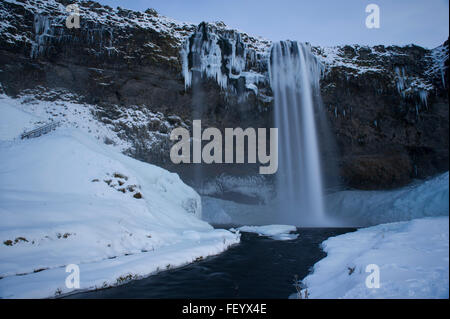 Seljalandsfoss Waterfall on the Golden Circle route during winter in Iceland - Stock Photo