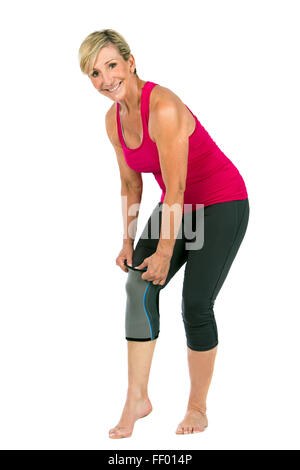 middle age woman with patellar knee brace - Stock Photo