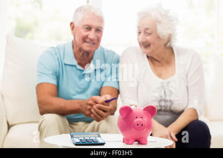Senior couple saving money - Stock Photo