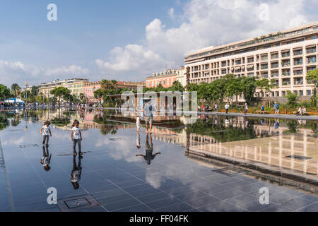 Promenade du Paillon water mirror fountain in the city center - Stock Photo