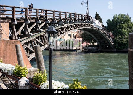 Ponte dell Accademia ( Accademia Bridge) across the Canale Grand ( Grand Canal) in Venice, Italy.  The wooden designed - Stock Photo