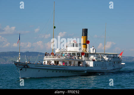 The Simplon steamboat arriving in the medieval city of Yvoire, France. Yvoire is located on the south shore of the - Stock Photo